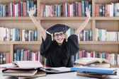 Excited bachelor studying in library — Stock Photo