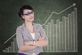 Professional businesswoman with business graph — Stock Photo