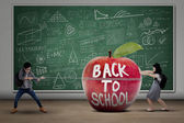 Two students back to school — Stock Photo