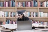Bachelor studying in library 1 — Stock Photo