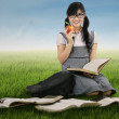 Female student studying outdoors — Stock Photo #51033873