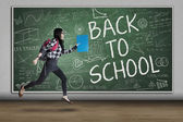 Enthusiastic student to school — Stock Photo