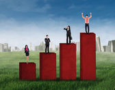 Business group standing on business chart — Stock Photo