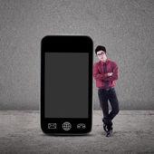 Businessman and smartphone — Stock Photo