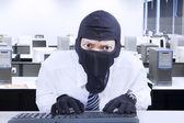 Businessman wearing mask stealing information 1 — Stock Photo
