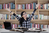 Cheerful student studying in library — Stock Photo