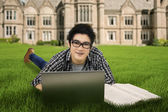 Male student studying outdoors 1 — Stock Photo