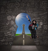 Student jumping at success door — Stock Photo