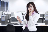Thoughtful businesswoman holding digital tablet — Stock Photo