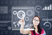 Woman work with gear on a futuristic interface — Stock Photo