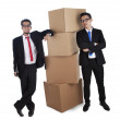 Businessmen with stack of boxes — Stock Photo #9231443