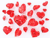 Ruby in the heart faceting. Sprinkle of diamonds. Valentine or wedding concept. Isolated on white background. 3d render — Foto Stock