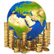 Planet Earth and a pile of gold coins — Stock Photo #37869545