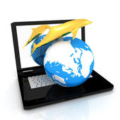 Golden Dolphin from the laptop. Global concept — 图库照片