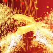 Delfín dorado - un símbolo de amor y devoción en aerosol de oro y estrellas sobre un fondo fantástico festivo — Foto de Stock