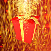 Red gift box with golden ribbon on fantastic background with a wave of stars — Stock Photo