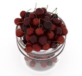 Bank of fresh cherries on a white background — Stock Photo