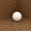 The white plastic ball in the corner of a brick — Stock Photo