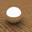 Chrome ball on the brick floor — Stockfoto