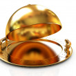 Glossy golden salver dish under a golden cover — Stock Photo