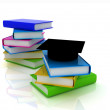 Grad hat with books on white — Stock Photo