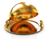 Glossy golden salver dish under a golden cover — Stok fotoğraf