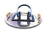 Phone and headphones on metal tray — Stock Photo