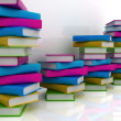 Stack of colorful real books on white background — Stock Photo #24240261