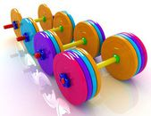 Colorful dumbbells — Stock Photo