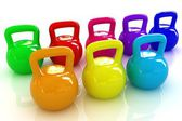 Colorful weights and dumbbells — Stock fotografie