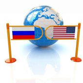 Three-dimensional image of the turnstile and flags of USA and Russia on a white background — Stock Photo