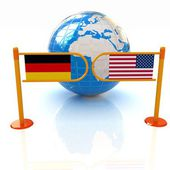 Three-dimensional image of the turnstile and flags of USA and Germany on a white background — Stock Photo