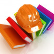 Stock Photo: Colorful books and hard hat
