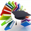 Stock Photo: Colorful books like rainbow and graduation hat
