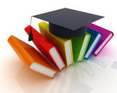Colorful books and graduation hat — Stock Photo