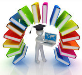 Colorful books like the rainbow and 3d man in a graduation hat with laptop — Photo