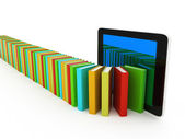 Tablet pc and colorful real books and on white background — Stock Photo