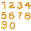 Stock Photo: Set of numbers 1,2,3,4,5,6,7,8,9,0 of gold coins with dollar