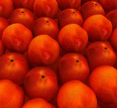 Lots of fresh peaches are beautiful peach background — Stock Photo