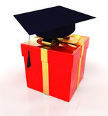 Graduation hat on a red gift — Stok fotoğraf