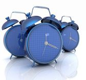 3d illustration of glossy alarm clocks against white background — Стоковое фото