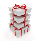 Gifts with ribbon on a white background — Stock Photo