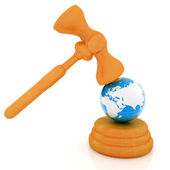 Wooden gavel and earth isolated on white background. Global auct — Zdjęcie stockowe
