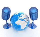 Global online with earth and mics — Stock Photo
