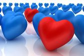 One red heart standing out in crowd — Stock Photo