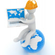3d man in a hard hat sitting on earth and working at his laptop — Stock Photo #49613537