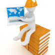 3d man in hard hat sitting on books and working at his laptop  — Stock Photo #49613555