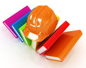 Colorful books and hard hat  — Stock Photo