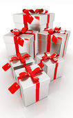 Gifts with red ribbon — Stock Photo