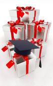 Graduation hat and gifts on a white background  — Stock Photo
